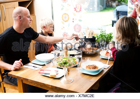 Family eating meal at restaurant - Stock Photo
