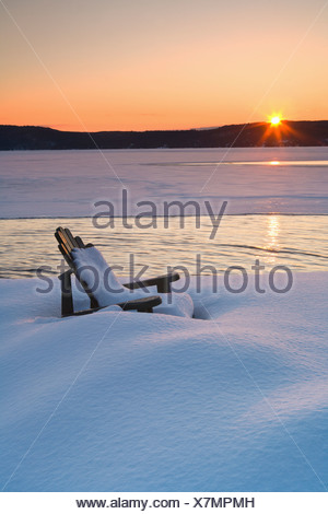 Deck chair on snow-covered sea - Stock Photo