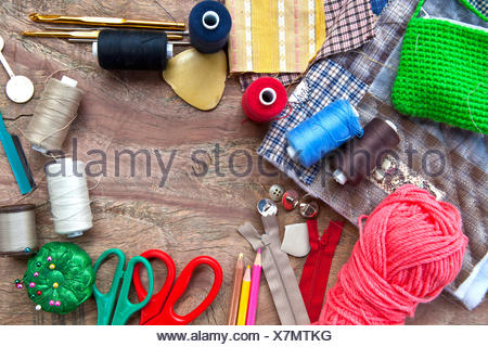 copy space inside accessories for repairing and fixing cloths, wood background - Stock Photo