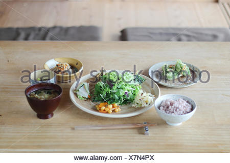 Japan, Dinner on wooden table - Stock Photo