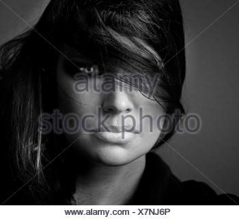 Close-Up Portrait Of Woman With Tousled Hair - Stock Photo