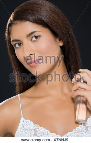 A woman applying perfume - Stock Photo