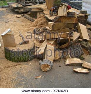 oak bark firewood muscularity service bark split stack firewood sawdust - Stock Photo