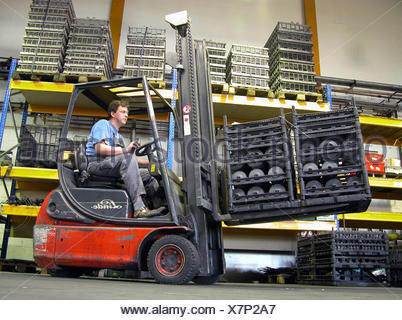 Forklift truck in a storage hall