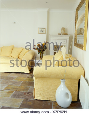 ... Pale Yellow Sofas Sofas In White Living Room With Slate Floor Tiles    Stock Photo