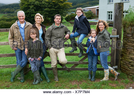 Generational family on farm - Stock Photo