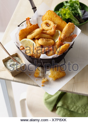 Bowl of onion rings and fried prawns - Stock Photo
