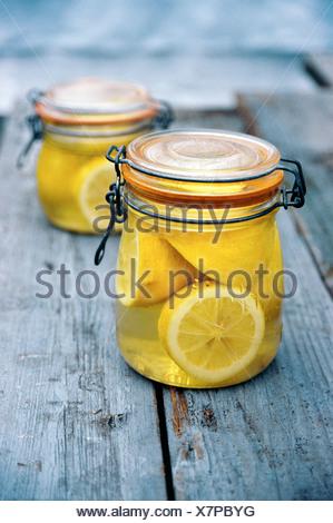 Jar of lemons in juice - Stock Photo