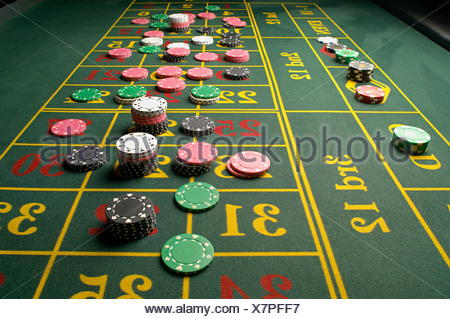 Gambling chips on a roulette table - Stock Photo