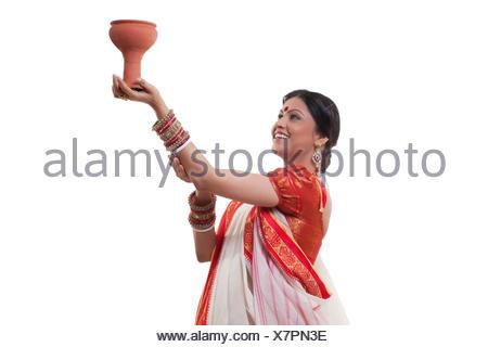 Bengali woman doing Dhunuchi dance - Stock Photo
