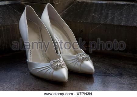 Close up of high heeled wedding shoes. - Stock Photo