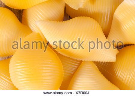 Conchiglie pasta, background of seashells, close up - Stock Photo