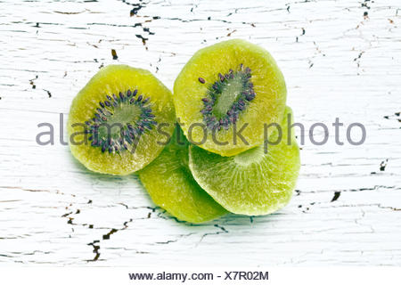 candied kiwi fruit on wooden table - Stock Photo