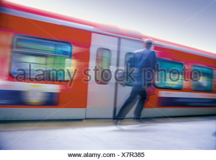 Man running after train - Stock Photo