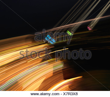 Seats spinning on chairoplane - Stock Photo