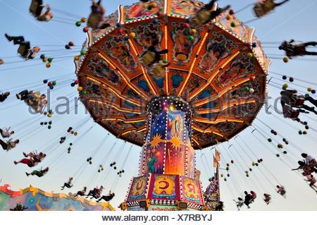 Chairoplane or chain carousel 'Wellenflug', Oktoberfest, Munich, Bavaria - Stock Photo