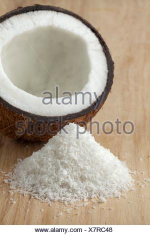 Coconuts with white shredded coconut meat close up. - Stock Photo