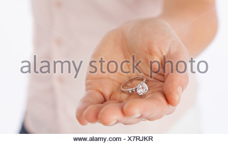 ... USA, Illinois, Metamora, Close Up Of Womanu0027s Hand Holding Engagement  Ring