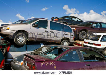 Cars in scrap yard - Stock Photo