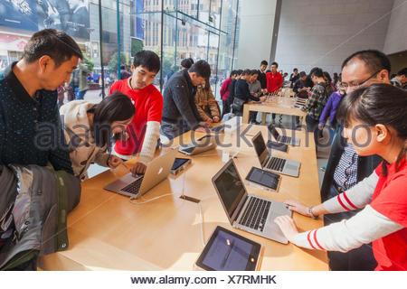 China, Shanghai, Nanjing Road, Interior of Apple Store - Stock Photo
