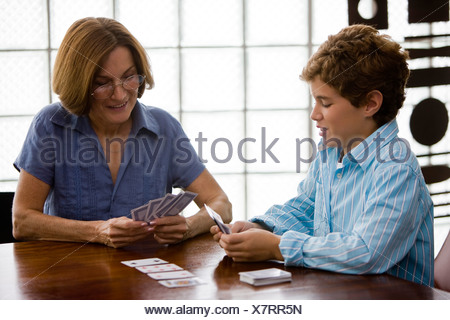 Woman playing cards with her grandson - Stock Photo