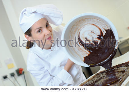 pouring melted chocolate - Stock Photo