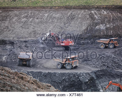 Diggers and dumper trucks at work in surface coal mine  Image downloaded by   at 22:04 on the 13/06/15 - Stock Photo