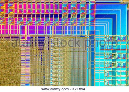 Light micrograph of a detail of a RAM computer memory chip. RAM is a type of computer memory that can be accessed randomly; that is, any byte of memory can be accessed without touching the preceding bytes.This is the most common type of memory found in personal computers and different other electronic devices like cellular phones, usb sticks and printers. Objcet size of this section approx. 1.2 mm across. - Stock Photo
