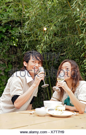 Young couple dinking, side view - Stock Photo
