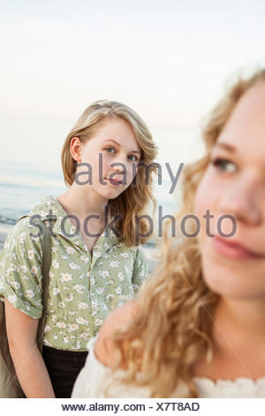 Sweden, Blekinge, Hallevik, Front view of two teenage girls (14-15, 16-17) at bay - Stock Photo