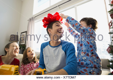 Playful family at home during Christmas - Stock Photo
