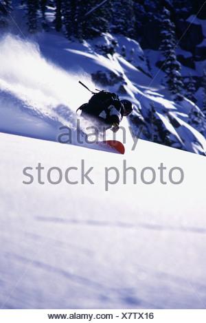 A man snowboarding in powder snow at Brighton UT - Stock Photo