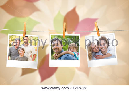 Composite image of instant photos hanging on a line - Stock Photo