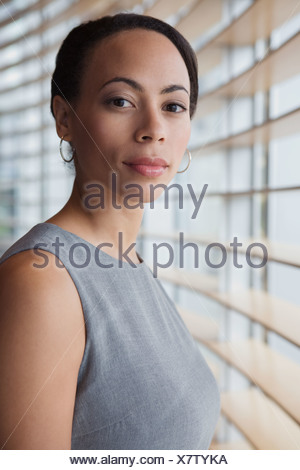 African woman next to window - Stock Photo