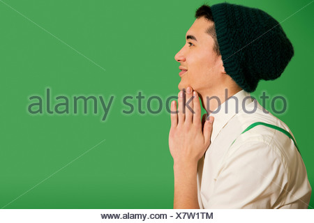 Portrait of young man wearing knit hat - Stock Photo