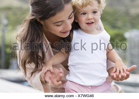 Close-up of happy mother playing with son - Stock Photo