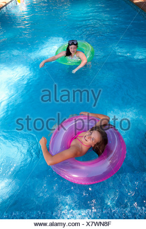 Friends playing in pool - Stock Photo