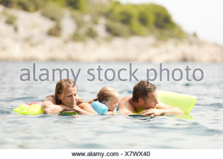 Family on inflatable mattress - Stock Photo