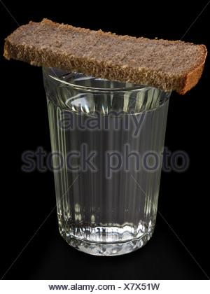 Bread food on vodka glass - Stock Photo