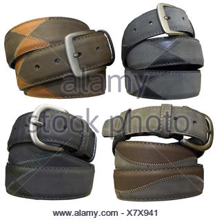 Four leather belts isolated on white background. - Stock Photo