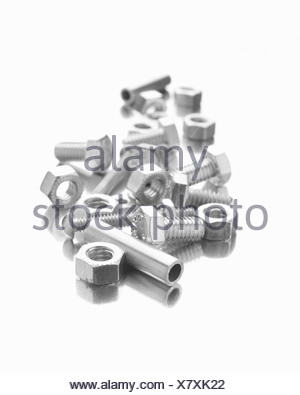 Nuts, bolts and sleeves on a white background - Stock Photo