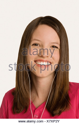 Teenage girl wearing headphones - Stock Photo