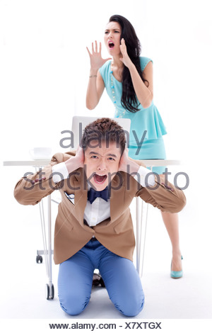 Frustrated young businesspeople shouting in office - Stock Photo