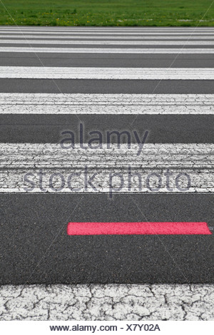 Detail of painted lines on an airport tarmac - Stock Photo