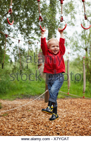 Toddler boy playing in playground - Stock Photo