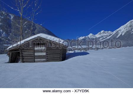 Austria, Europe, Tyrol, Gurgltal, Nassereith, winter, Stadel, hay barn, snow, mountains, Mieminger chain, Marienbergspitze, wood - Stock Photo