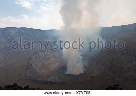 Smoking crater of Mount Nyiragongo volcano - Stock Photo