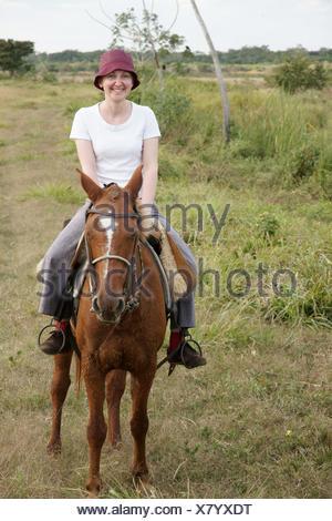 Woman Riding, Pantanal, Mato Grosso do Sul, Brazil - Stock Photo