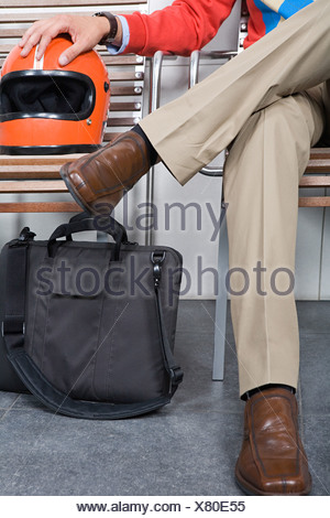 Man in chair with helmet - Stock Photo