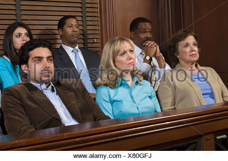 Jurors in courtroom during trial - Stock Photo